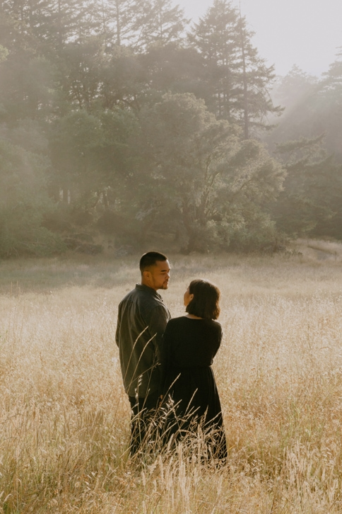 Kristine and Charles, two adventurous wedding and elopement videographer and photographers in California, embracing.