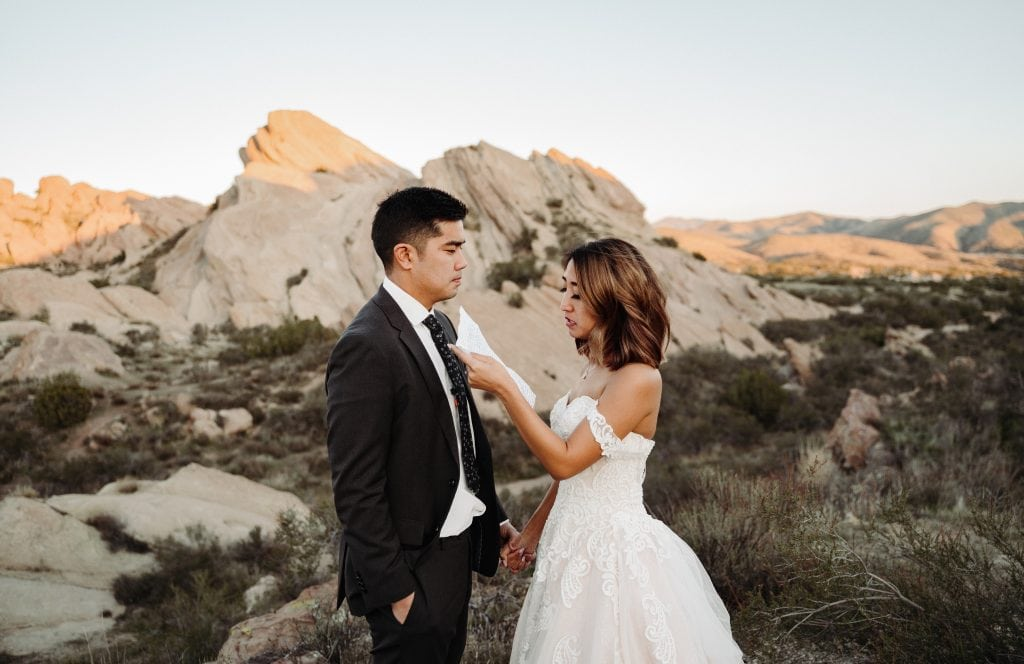 A couple reading their vows during a desert elopement in California.