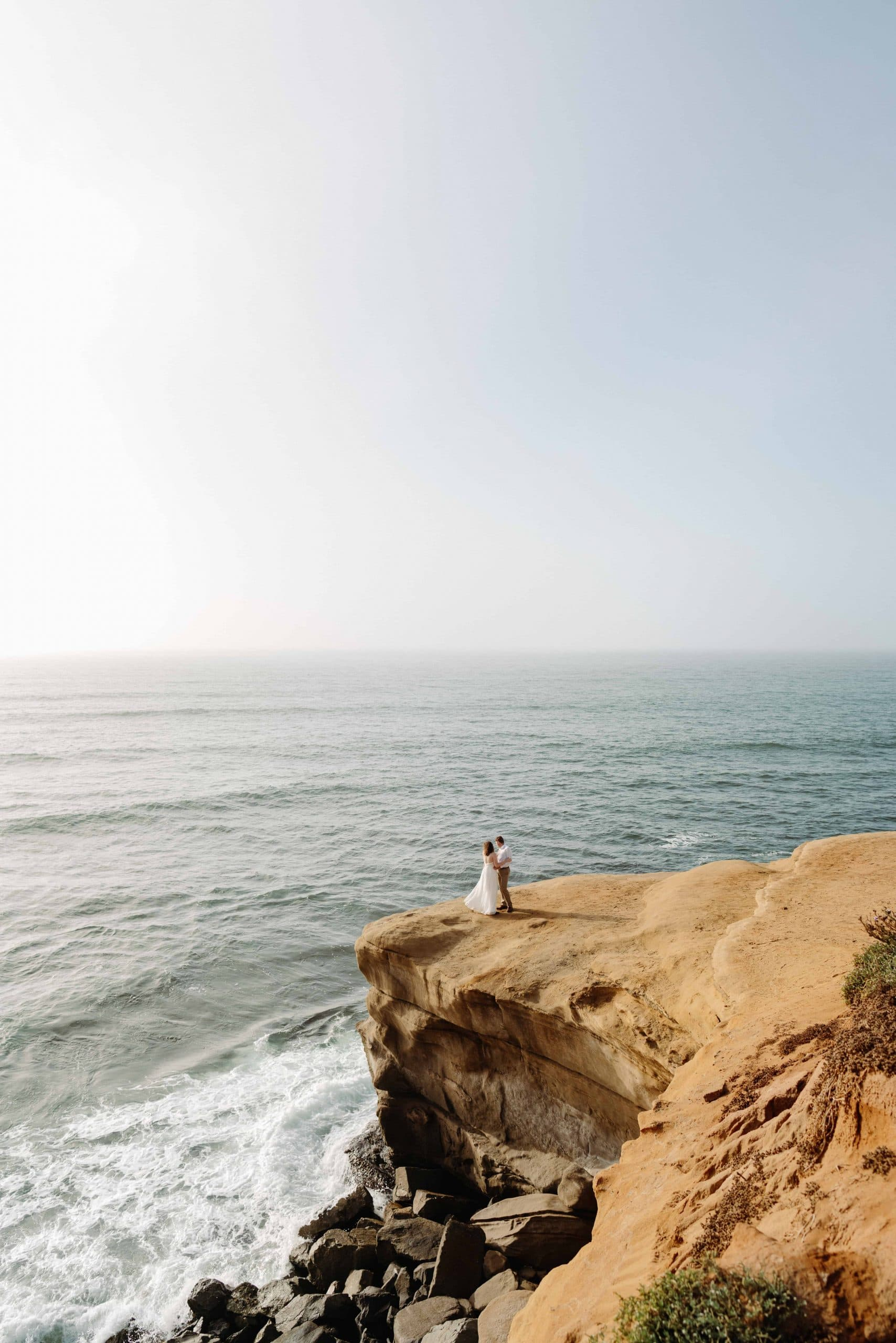 A couple looking into the ocean at their San Diego Elopement in Sunset Cliffs