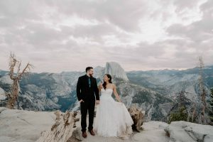 After their wedding ceremony, a bride and groom hold hands at their Yosemite elopement