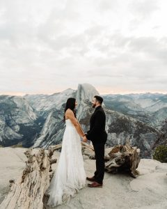 A couple who eloped in Southern California in Yosemite National Park face each other and share a moment after their elopement in Yosemite National Park.